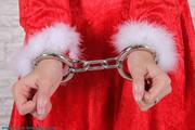 Christmas girl Maren in number locked cuffs 2