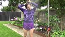 Watching Aiyana wearing a sexy purple shiny nylon shorts and a purple rain jacket while taking a shower in the garden (Video) 0
