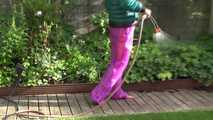 Watching Sandra taking a sun bath and watering the garden the pest plants wearing a sexy purple rain pants and a green down jacket (Video) 1