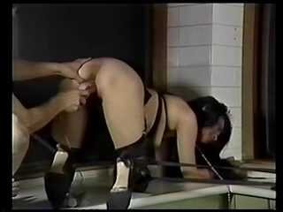 Working on her holes: Master is training his slavegirl's holes with various toys.