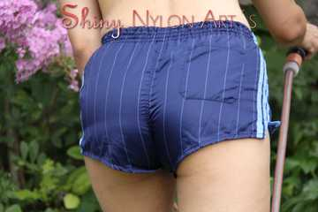 Watching Aiyana wearing only a sexy blue shiny nylon shorts watering the garden (Pics)