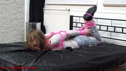 Tight hogtie with pink ropes