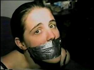 Nongrid_medium_uk-girl-f0rced-to-tape-handcuff-gag-herself-d13-15