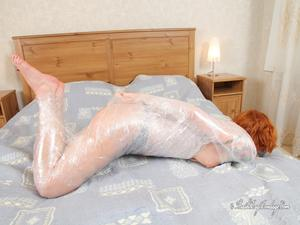 Nongrid_medium_any-frost-mummified-in-cling-film-topless-2