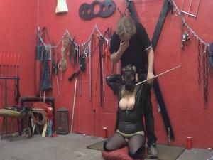Nongrid_medium_latex-slave-tits-treatment-with-cane