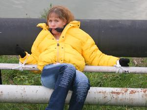 Nongrid_medium_leonie-tied-and-gagged-outdoor-wearing-a-shiny-yellow-downjacket-pics