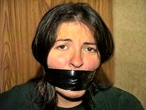 Nongrid_medium_first-grade-latina-school-teacher-is-wrap-gagged-with-semi-clear-brown-packaging-tape-black-electrical-tape-silver-duct-tape-mouth-stuffed-with-rag-d69-4