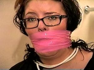 Nongrid_medium_25-year-old-day-care-worker-is-mouth-stuffed-handgagged-wrap-bondage-tape-gagged-toe-tied-wearing-nylon-stockings-while-tied-to-a-chair-and-wearing-eye-glasses-d72-6