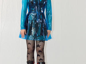 Nongrid_medium_nadja-shows-her-short-black-pvc-dress-under-a-blue-raincoat