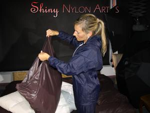 Nongrid_medium_watching-sandra-wearing-shiny-nylon-rainwear-while-preparing-bed-and-feeling-good-in-that-stuff-showing-her-sexy-bud-pics