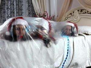 Nongrid_medium_lucky-nelly-xenia-santas-little-helpers-hogtied-and-wrapped-up-on-a-bed-video