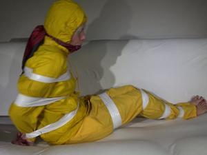 Nongrid_medium_watching-pia-wearing-a-sexy-yellow-rainwear-being-tied-and-gagged-with-tape-and-a-ballgag-on-a-sofa-video