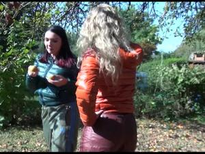 Nongrid_medium_watching-jill-and-sophie-while-they-collect-apples-and-strolling-through-the-garden-both-wearing-sexy-shiny-rain-pants-and-down-jackets-on-naked-skin-video