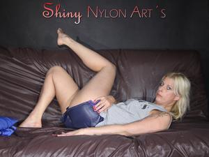 Nongrid_medium_watching-pia-enjoying-herself-in-sexy-shiny-nylon-shorts-and-a-tshirt-pics