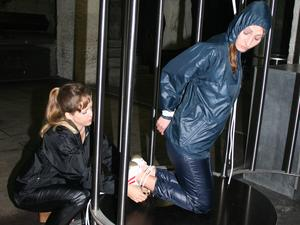 Nongrid_medium_old-stuff-inedited-watching-stella-being-tied-and-gagged-in-a-cage-from-leonie-with-ropes-and-a-ball-gag-both-wearing-sexy-shiny-nylon-rainwear-pics