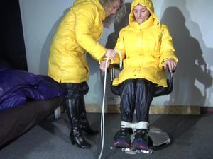Nongrid_medium_sexy-sandra-being-tied-and-gagged-from-sophie-on-a-hairdressers-chair-with-ropes-and-a-holster-both-wearing-super-shiny-shiny-nylon-pants-and-yellow-down-jackets-video