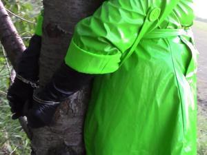 Nongrid_medium_handcuffed-in-green-shiny-raincoat