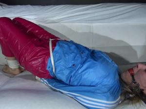 Nongrid_medium_sexy-sandra-being-tied-and-gagged-on-a-sofa-with-ropes-and-a-ball-gag-wearing-a-supershiny-sexy-red-rain-pants-and-a-lightblue-rain-jacket-video