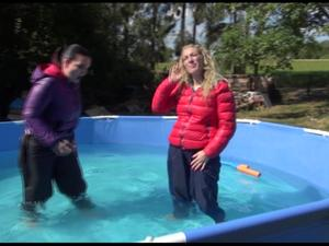 Nongrid_medium_watching-sophie-and-jill-wearing-supersexy-shiny-black-shiny-nylon-pants-and-down-jackets-enjoying-eachother-and-the-wet-clothes-in-the-swimming-pool-video