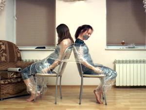 Nongrid_medium_olivia-niki-trash-bag-fashion-leads-to-wrapped-on-the-chairs-video