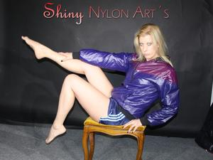 Nongrid_medium_watching-sexy-pia-in-a-sexy-oldschool-blue-shiny-nylon-shorts-and-a-special-rain-jacket-posing-for-you-on-a-little-chair-pics
