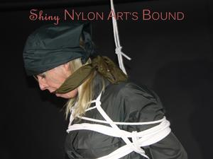 Nongrid_medium_sexy-pia-wearing-a-special-green-rainwear-combintaion-with-a-special-hood-being-tied-and-gagged-with-ropes-and-a-clothgag-overhead-pics