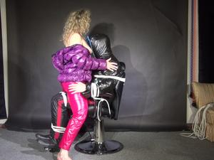 Nongrid_medium_video-story-the-second-part-watching-sophie-while-she-enjoys-to-stimulate-her-and-her-victim-who-is-tied-and-gagged-on-a-hairdressers-chair-both-wearing-shiny-nylon-down-jackets-an-rain-pants-video