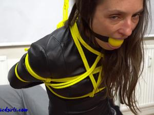 Nongrid_medium_tied-and-gagged-leather-lady