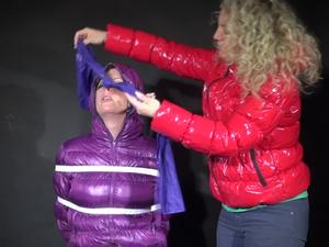 Nongrid_medium_watching-pia-being-tied-and-gagged-with-belts-and-a-ball-gag-on-a-stool-from-sophie-wearing-a-sexy-purpleblue-downwear-combination-video