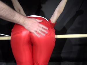 Nongrid_medium_watching-sophie-wearing-a-hot-red-shiny-nylon-jumpsuit-being-tied-and-gagged-overhead-bended-over-a-bar-video