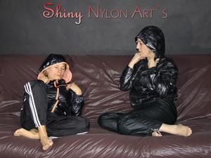 Nongrid_medium_watching-sophie-and-sandra-preparing-the-sofa-for-lolling-on-it-both-wearing-sexy-black-shiny-nylon-rainwear-pics