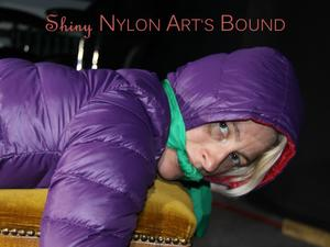 Nongrid_medium_watching-sexy-sonja-being-tied-and-gagged-with-ropes-and-a-cloth-gag-on-a-stool-wearing-a-sexy-shiny-nylon-rain-pant-and-a-purple-down-jacket-pics