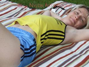 Nongrid_medium_sexy-sonja-wearing-a-lightblue-shiny-nylon-shorts-with-a-yellow-top-durig-her-bath-in-the-sun-pics