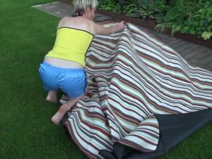 Nongrid_medium_sexy-sonja-wearing-a-lightblue-shiny-nylon-shorts-and-a-yellow-top-enjoying-the-sun-video